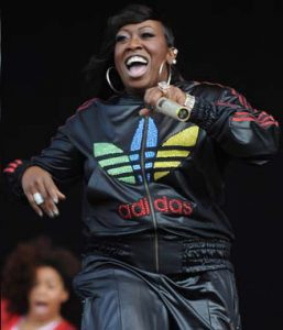 Missy Elliott on stage with microphone